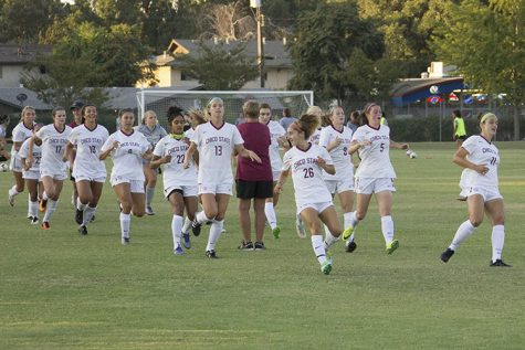 The women's soccer team takes to the field in their final game of the season. Photo credit: Aubrie Coley