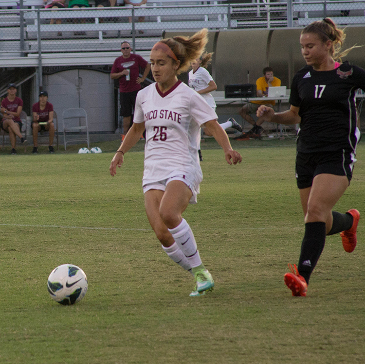 Junior defender Brooke Coelho attempts to pass the ball to a teammate. Photo credit: Aubrie Coley
