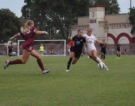 First-year forward Abbie Jones battles for the ball as first-year goalkeeper Caylin Stanley rushes to assist. Photo credit: Makayla Hopkins