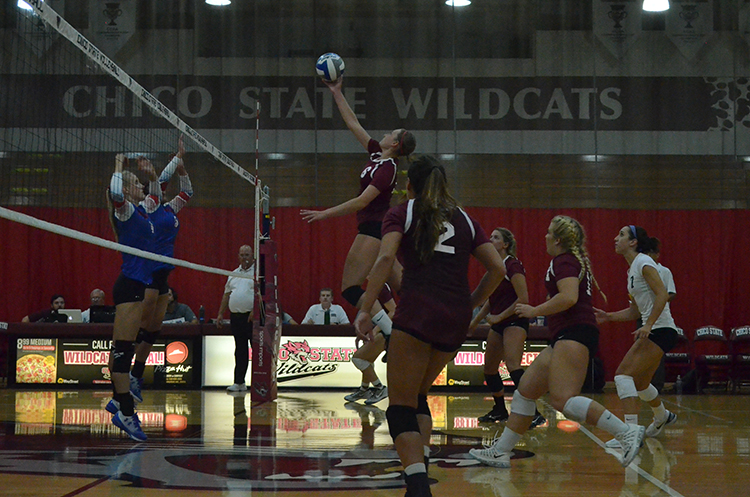 Junior outside hitter Anna Baytosh floats the ball over the net. Photo credit: Jordan Jarrell