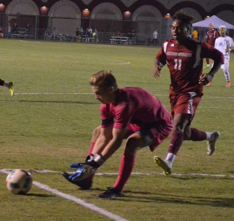Men's soccer team picks up first conference win