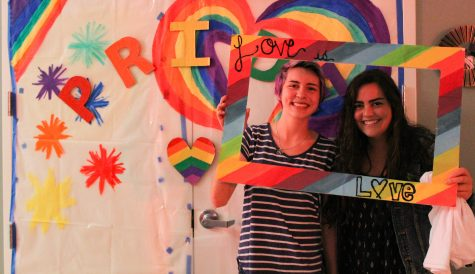 First-year biology major, Sophia Balme (right) and first-year business administration major, Tyler Wallace (left), take advantage of the Pride themed interactive photo booth. Photo credit: Jae Siqueiros