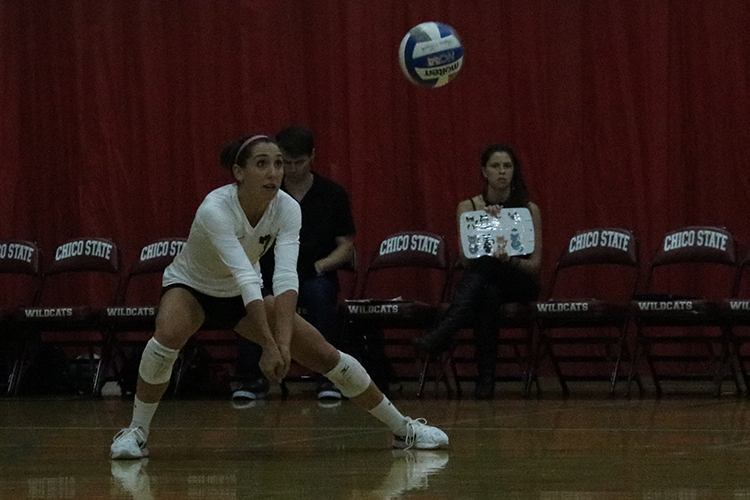 Senior defensive player Shannon Cotton performs a dig during a Wildcat home game. Photo credit: Jovanna Garcia