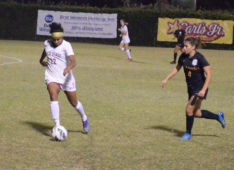 Pooja Patel dribbles the ball away from a defender during a 'Cats home game. Photo credit: Jordan Jarrell