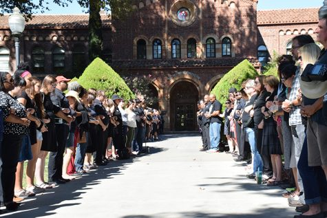 Members of the Chico State community gather in front of Kendall Hall during a silent protest. Photo credit: Royal T Lee-Castine