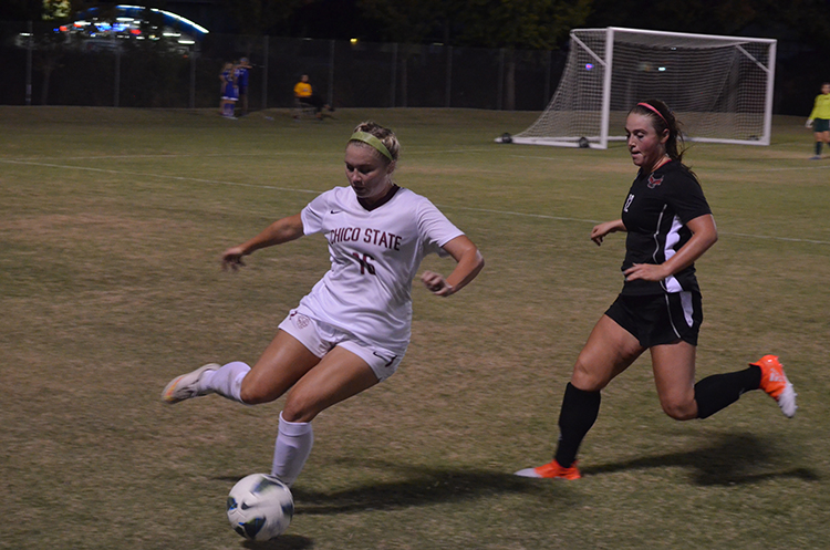 Brielynn Tovani juggles the ball away from a defender. Photo credit: Jordan Jarrell