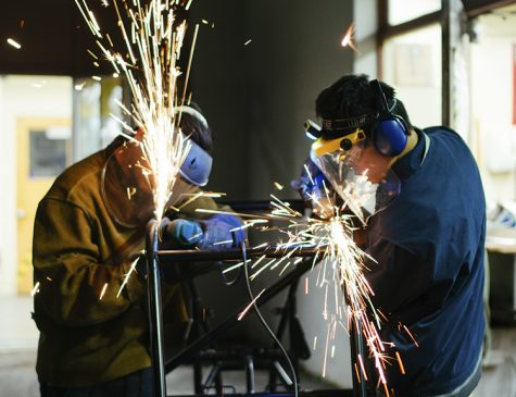 Two club members welding metal. Photo courtesy by Carson Schmeck.