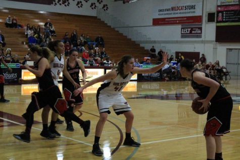 Sophomore forward McKena Barker contests a shot during a Wildcat home game. Photo credit: Jordan Olesen