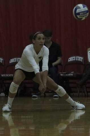 Senior defensive Shannon Cotton attempts a dig during the game against Sonoma State. Photo credit: Jovanna Garcia