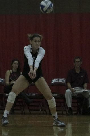 First-year outside hitter Kim Wright hits the ball during a Wildcat home game. Photo credit: Jovanna Garcia
