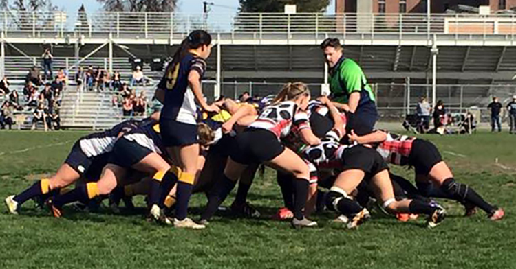 During a game opener, the women's rugby team battles for the ball. Photo credit: Makayla Hopkins