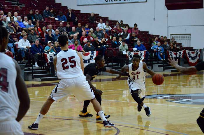 Jalen McFerren drives the ball inside during a Wildcat home game. Photo credit: Caio Calado