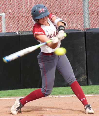 Sophomore Rachel Dehart swings at a pitch. Photo credit: Nick Martinez-Esquibel