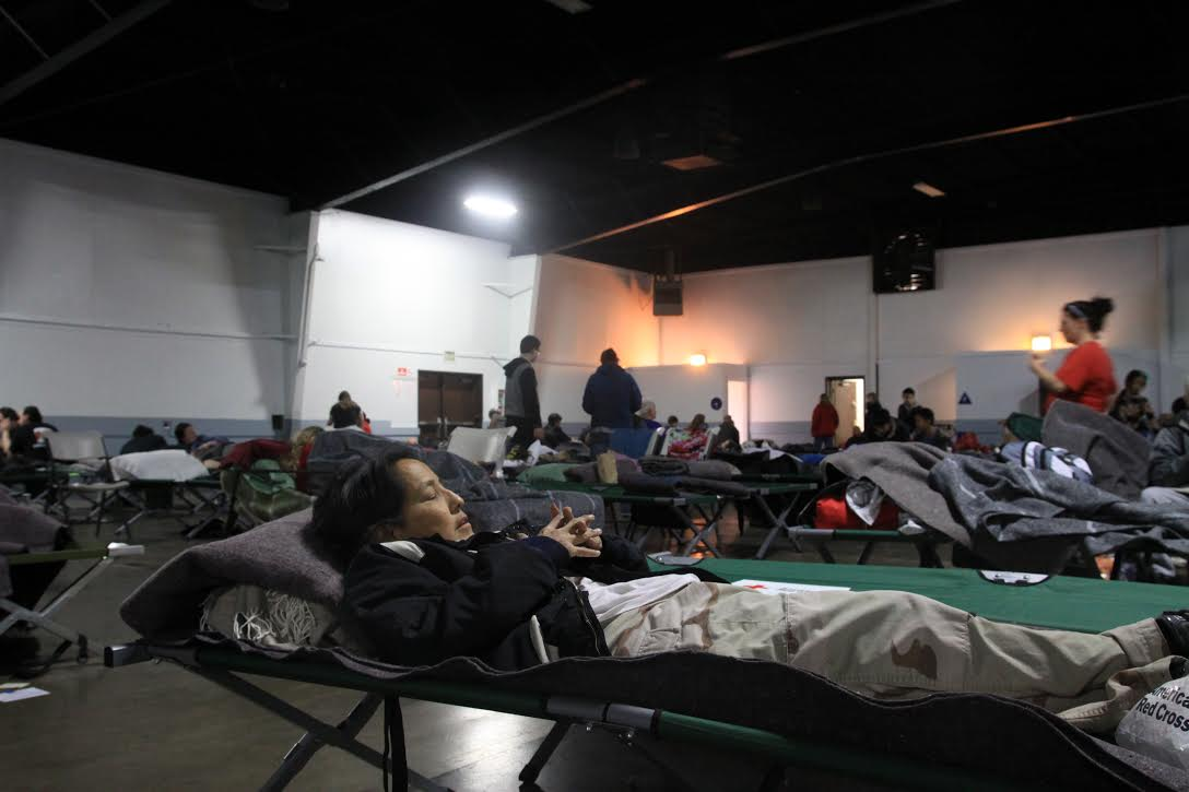 Evacuees rest in their cots at the Silver Dollar Fairgrounds. Photo credit: Miguel Orozco