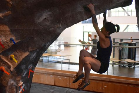Climber Miranda Santana hangs from the boulder as she attempts to pull herself back up. Photo credit: Miguel Orozco
