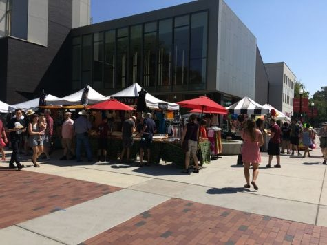 Booths and food stands outside the new Arts and Humanities building.