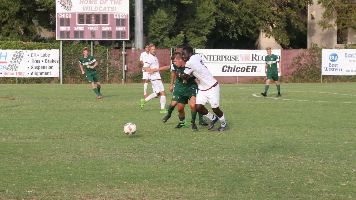Junior forward Jeremiah Egujie fights for the ball against a defender.