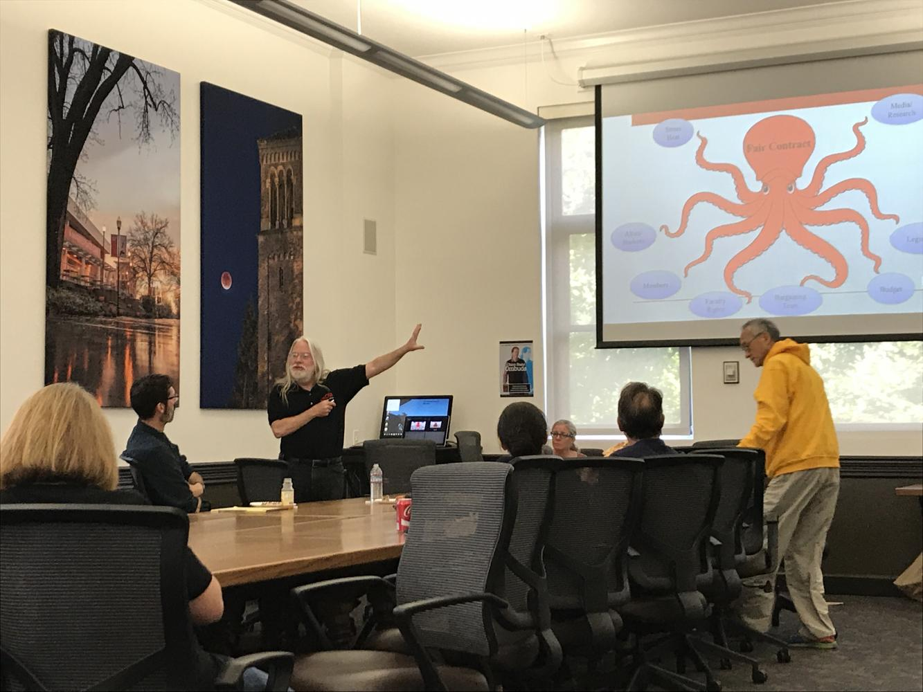 David Bradfield going over the tentative agreement using an octopus demonstration. Photo credit: Hannah Yeager