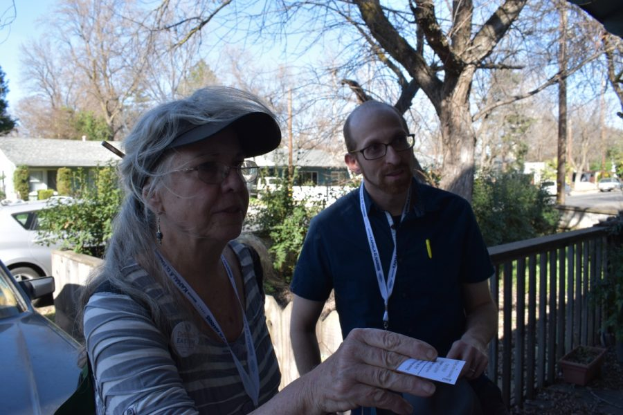 Robin Keehn and Asa Mittman hand out information about voter training to a Chico resident. Photo credit: Alex Grant