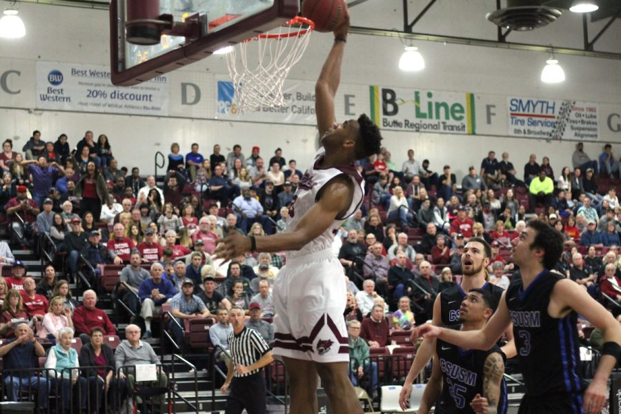 Justin Briggs (25) slams home a dunk in Satuday's matchup against Cal State San Marcos. Photo credit: Kailah Cabiles