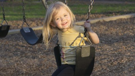 Eliza Lee plays on the swing set at Five Mile, Bidwell Park, on Monday while spending time with her grandmother. Photo credit: Carly Maxstone