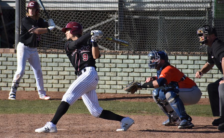 Second baseman Brian Pozos hits a triple for 2 RBIs in the bottom of the seventh inning in the first game of the double header against Fresno Pacific. Photo credit: Martin Chang