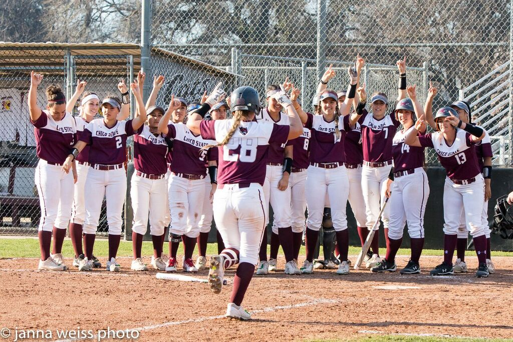 The Wildcats welcome Karli Skowrup home following one of her two home runs on the weekend. Photo credit: Janna Weiss Photography
