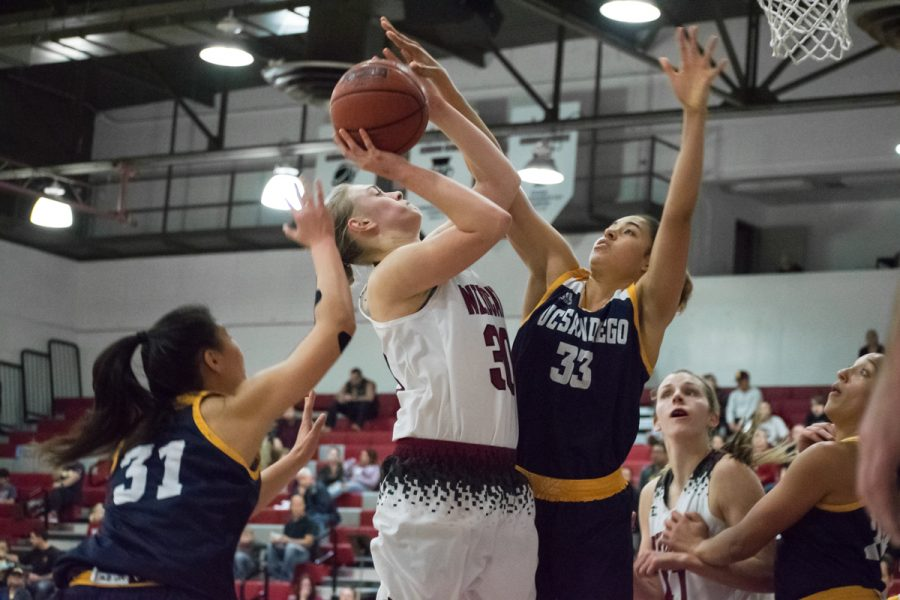 Wildcat+of+the+Week%2C+Kayla+Taylor+%2830%29%2C+forces+a+shot+against+her+opponent+and+gets+fouled.+Photo+credit%3A+Kate+Angeles