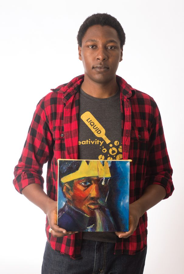 Local artist Martin Townsend presents one of his paintings. Photo credit: Sean Martens