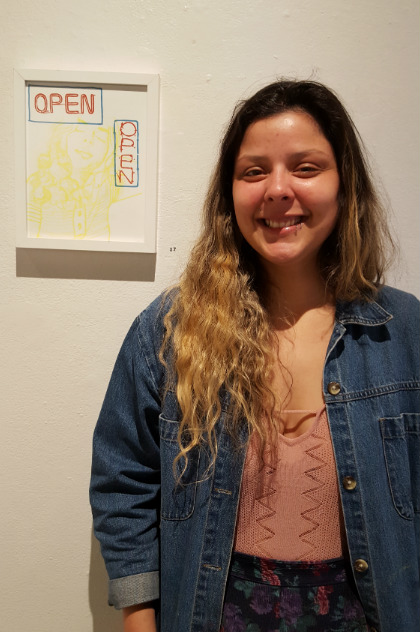 Marisa Segovia is one of 20 art students and alumna displaying her work at the Art Exhibition on campus. Photo credit: Tisha Cheney