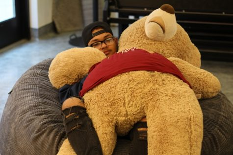 On February 6th, Maury Montalvo spent his gap between classes lounging in the Hub watching Netflix and hugging Chuck. Photo credit: Kailah Cabiles
