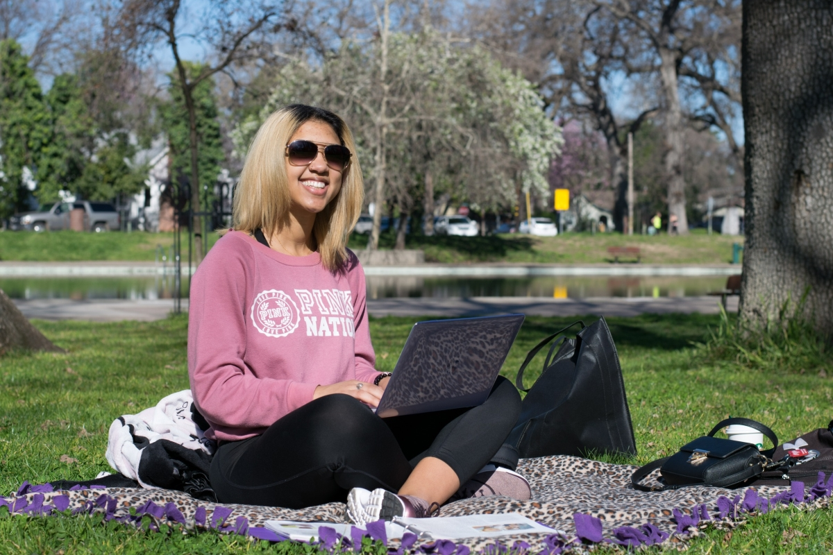 Chico resident, Kaesha Abrams, enjoys the Friday morning sunshine with a study session at Bidwell Park Photo credit: Kate Angeles