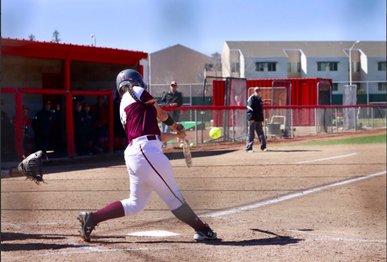 First baseman Cyrena Taylor hits a home run for the Wildcats. Photo Courtesy: Janna Weiss Photography