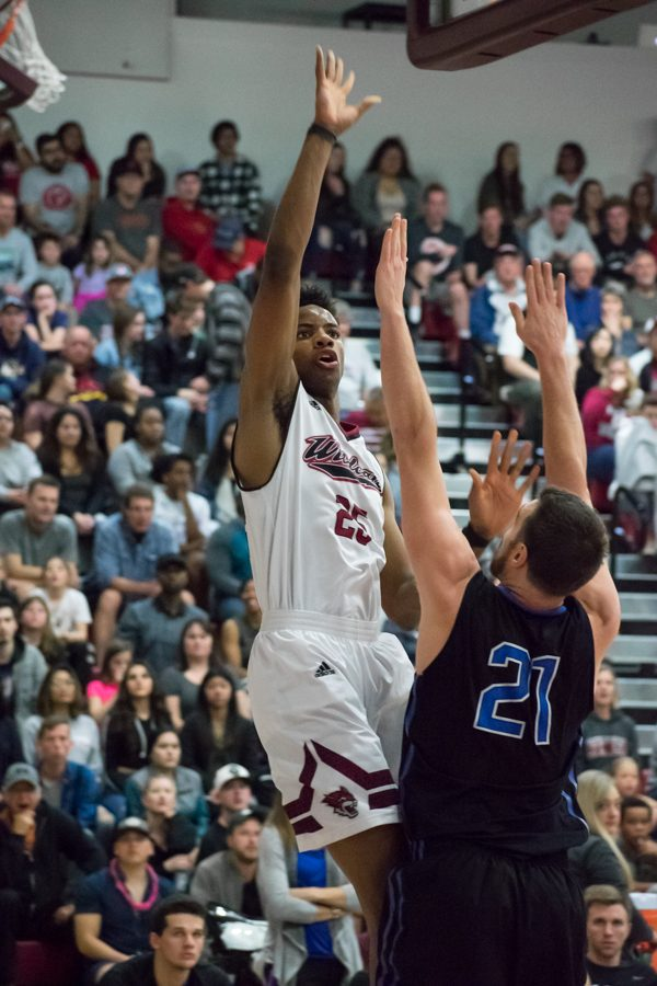 Sophomore Justin Briggs avoids defense and finds an open shot in a Chico's playoff matchup against Cal State San Bernardino. Photo credit: Kate Angeles