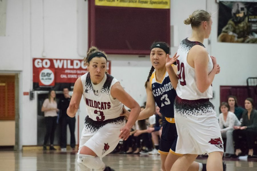Senior Kayla Taylor, 30, sets a screen for fellow senior Whitney Branham, 3, against UCSD. Both were award winners for the Wildcats Photo credit: Kate Angeles