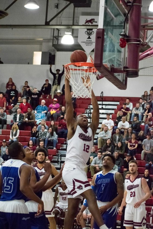 Junior+forward%2C+Marvin+Timothy+throws+down+a+dunk+for+the+Wildcats.+Photo+credit%3A+Kate+Angeles