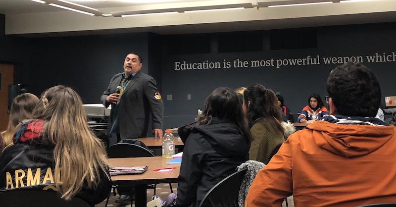 Dr. César A. Cruz presented to a packed room at Selvester's Cafe. Photo credit: Alejandra Fraga