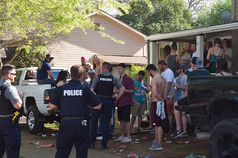 Cops break up a party.