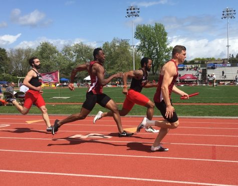 Chico State's Derrick Shepherd and Windsor Jamison complete the transfer of the baton in the 4x100 relay on Saturday. The team finished third with a time of 42.75 seconds. Photo credit: Andrew Baumgartner