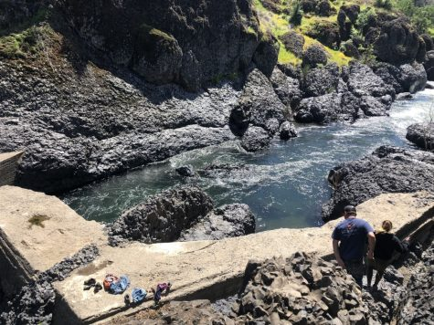 Swimmers taking a dip while a couple hikes down to the water. Photo credit: Courtney Chapman