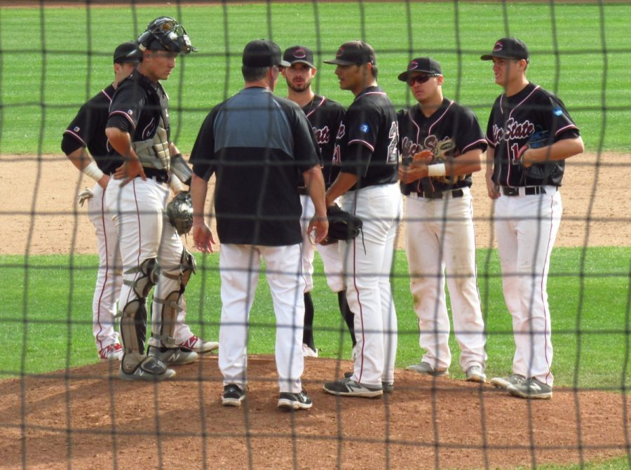 Chico State Head Coach Dave Taylor makes a mound visit and brings his whole infield in following back-to-back errors against Northwest Nazarene. Photo credit: Austin Schreiber