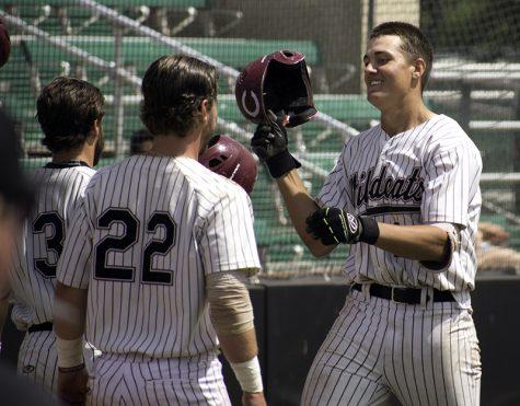 Kyle Blakeman celebrates with fellow seniors RJ Hassey, 22, and Cameron Santos, 23, following his solo home run Sunday. Photo credit: Martin Chang