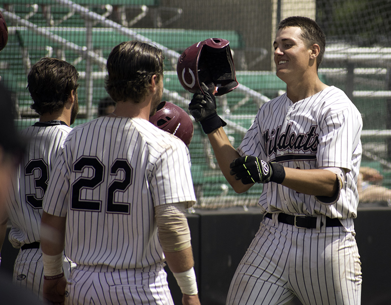 Kyle Blakeman celebrates with fellow seniors RJ Hassey, 22, and Cameron Santos, 23, following his solo home run Sunday. Photo credit: Martin Chang