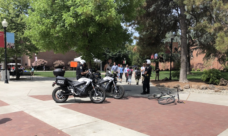 A man was cited Tuesday for riding his bicycle in the busy area by Trinity Hall. Photo credit: Natalie Hanson