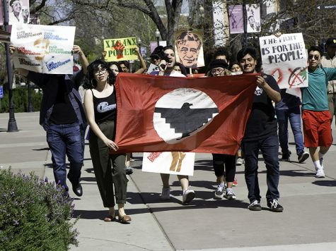 Marchers marching to honor Cesar Chavez and others begin their march on campus on March 31.
