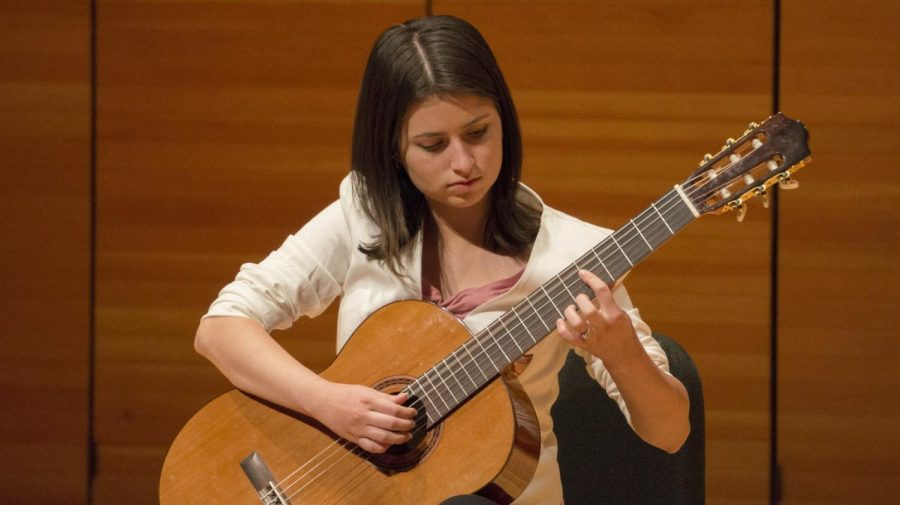 Briaunna Cisneros plays the opening piece for the ensemble performance. Photo credit: Carly Maxstone