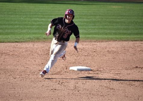 Wildcats third baseman Cameron Santos rounds second base in a matchup against Fresno Pacific. Photo credit: Martin Chang