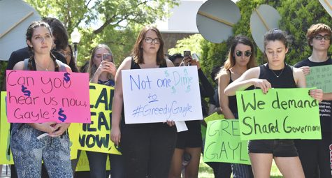 Student protesters gather near Kendall Hall Monday to voice strong opinions against the student fee increases. Nearly 50 students attended and some gave speeches before leading rally chants. Photo credit: Alex Grant