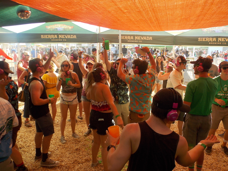 Pink headphones played music directly to dancing campers Saturday at Beer Camp, allowing a dance party without the music overpowering the other activities Photo credit: Josh Cozine