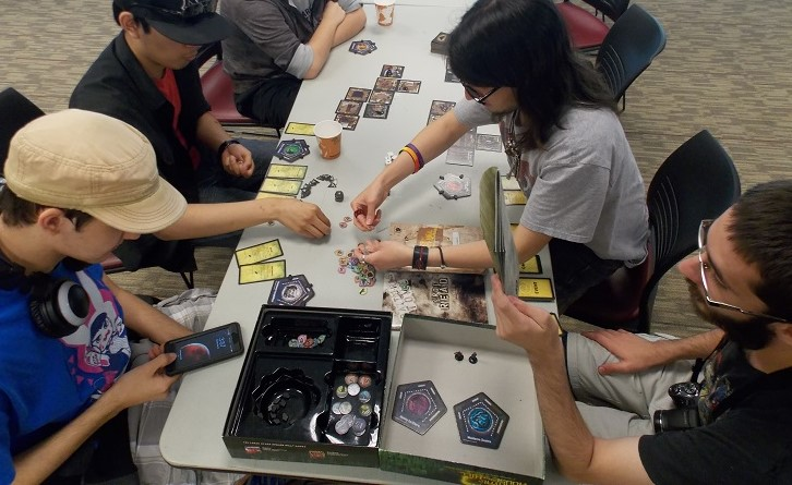 The game Betrayal at the house on the hill was played by students and members of Wildcat Gaming, From left-to-right, Julian Pierson, Aaron Dizon, Alexander Lopez, and Theron Rex Howard, Saturday during a character creation party. Photo credit: Josh Cozine